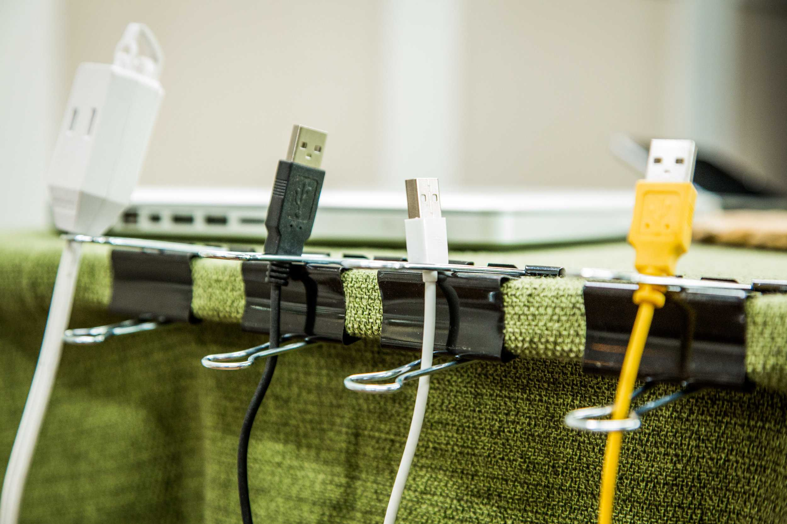 Keep track of computer cables with binder clips, which are surprising DIY desk organization ideas!