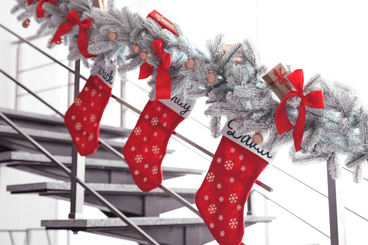 Stockings with snowflakes and ribbons as decorations for your office holiday party.