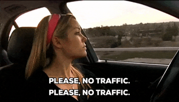 """Woman driving in a car with text """"please no traffic"""""""