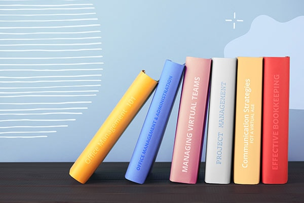 6 books about office management topics leaning against each other on a shelf