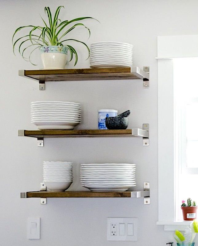 Wooden hanging shelves used for extra storage in an office kitchen.