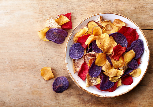 An assortment of veggie chips in a bowl