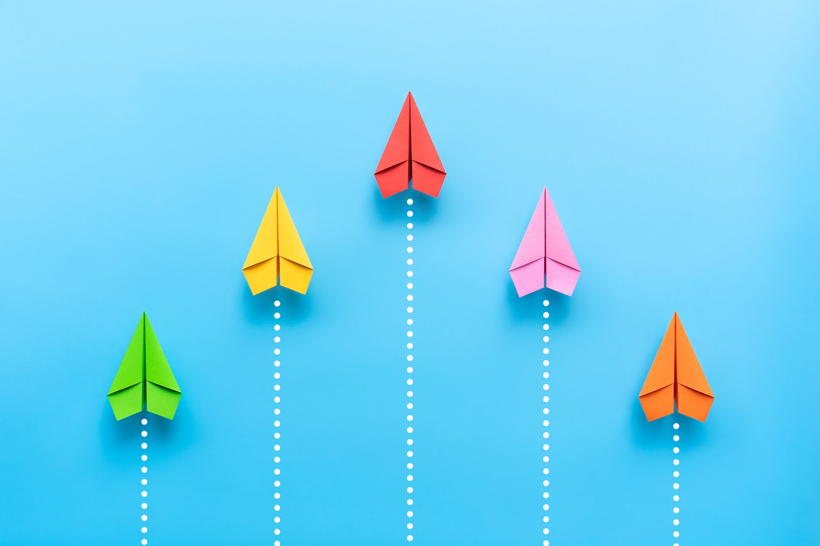 What is company culture: Colorful paper planes symbolizing company growth