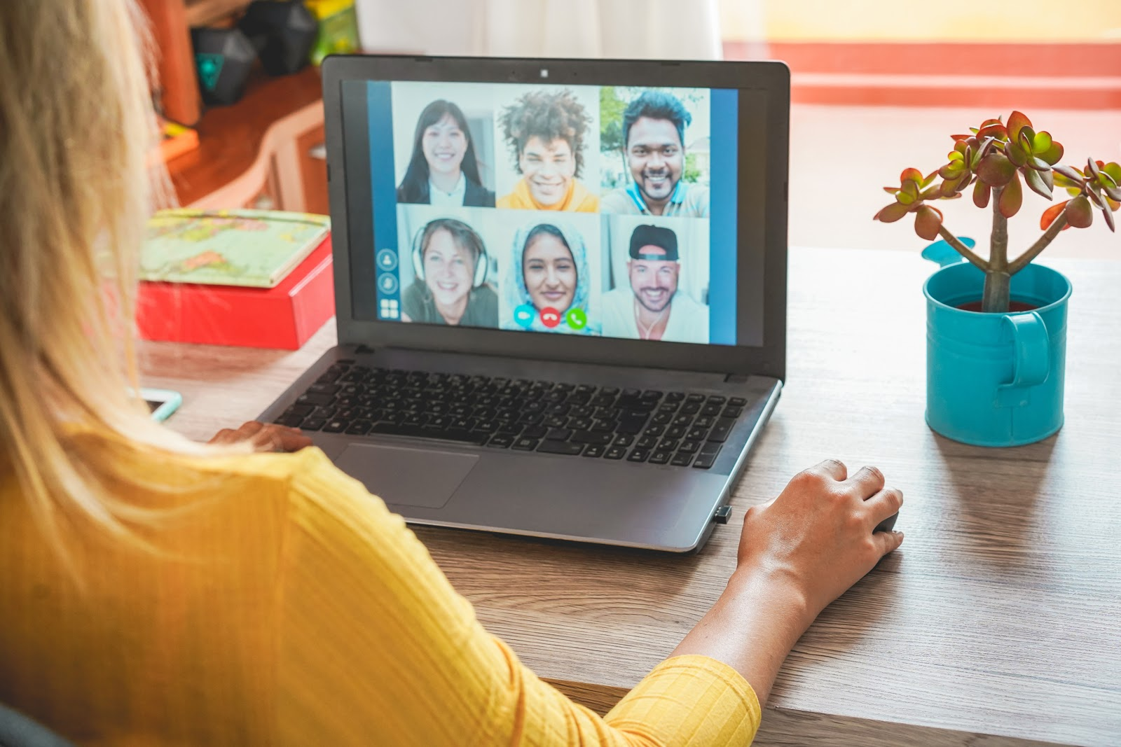 Team members enjoy a team call as part of a virtual retreat