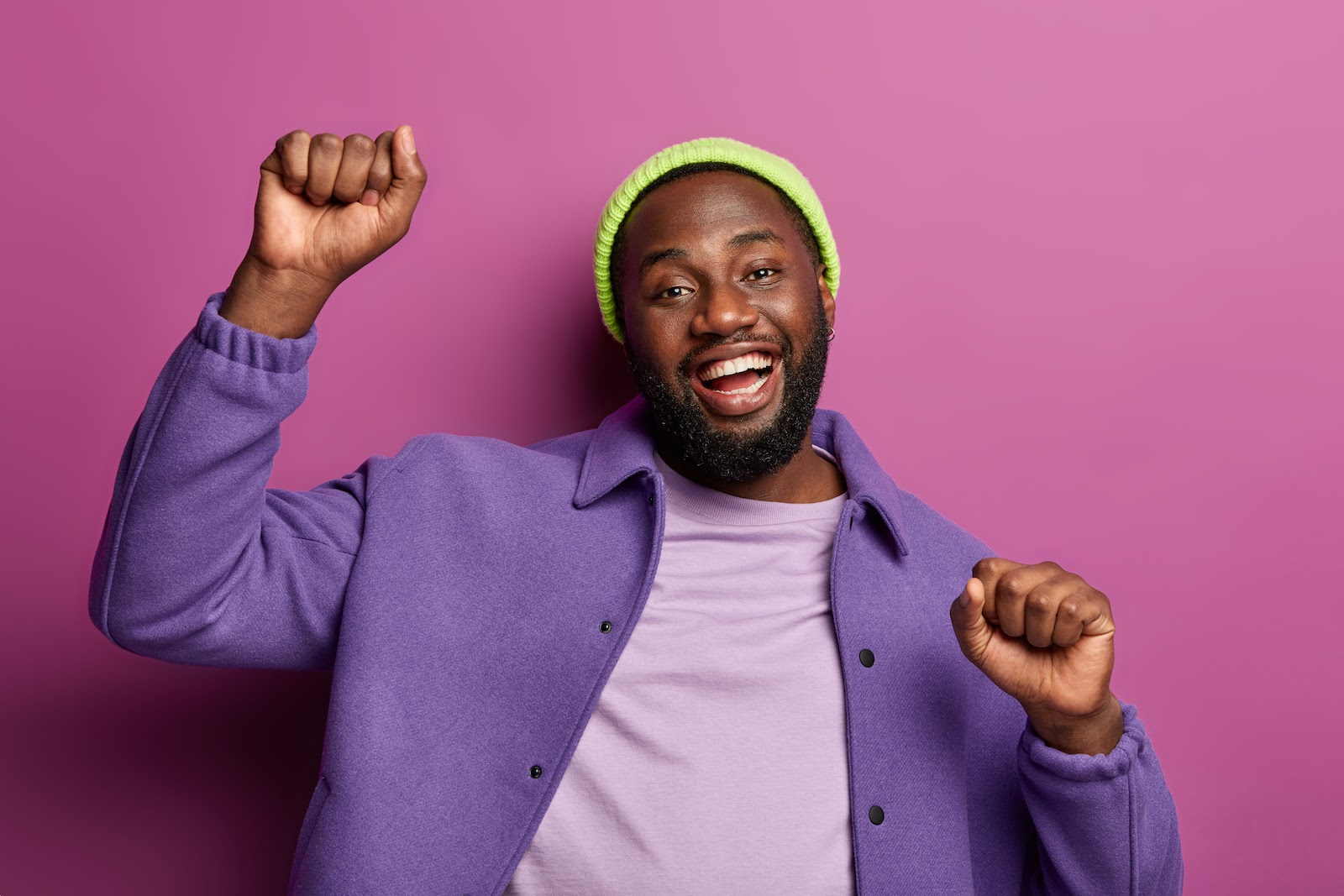 An excited employee on a pink background
