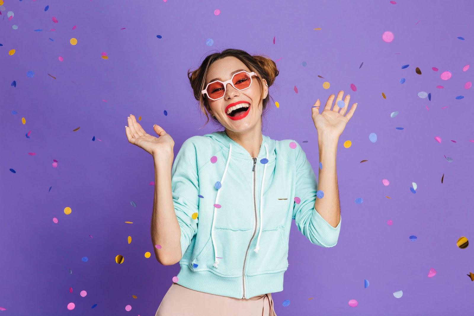 A happy team member throws confetti