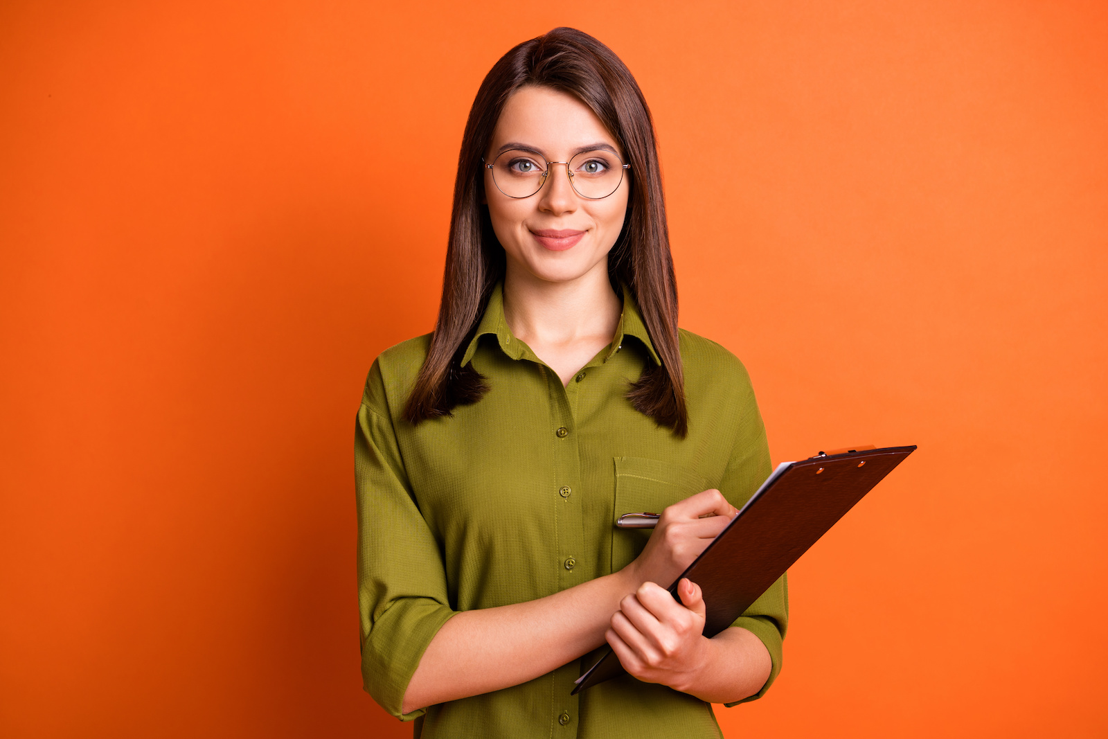 A woman holds an event planning checklist on a clipboard