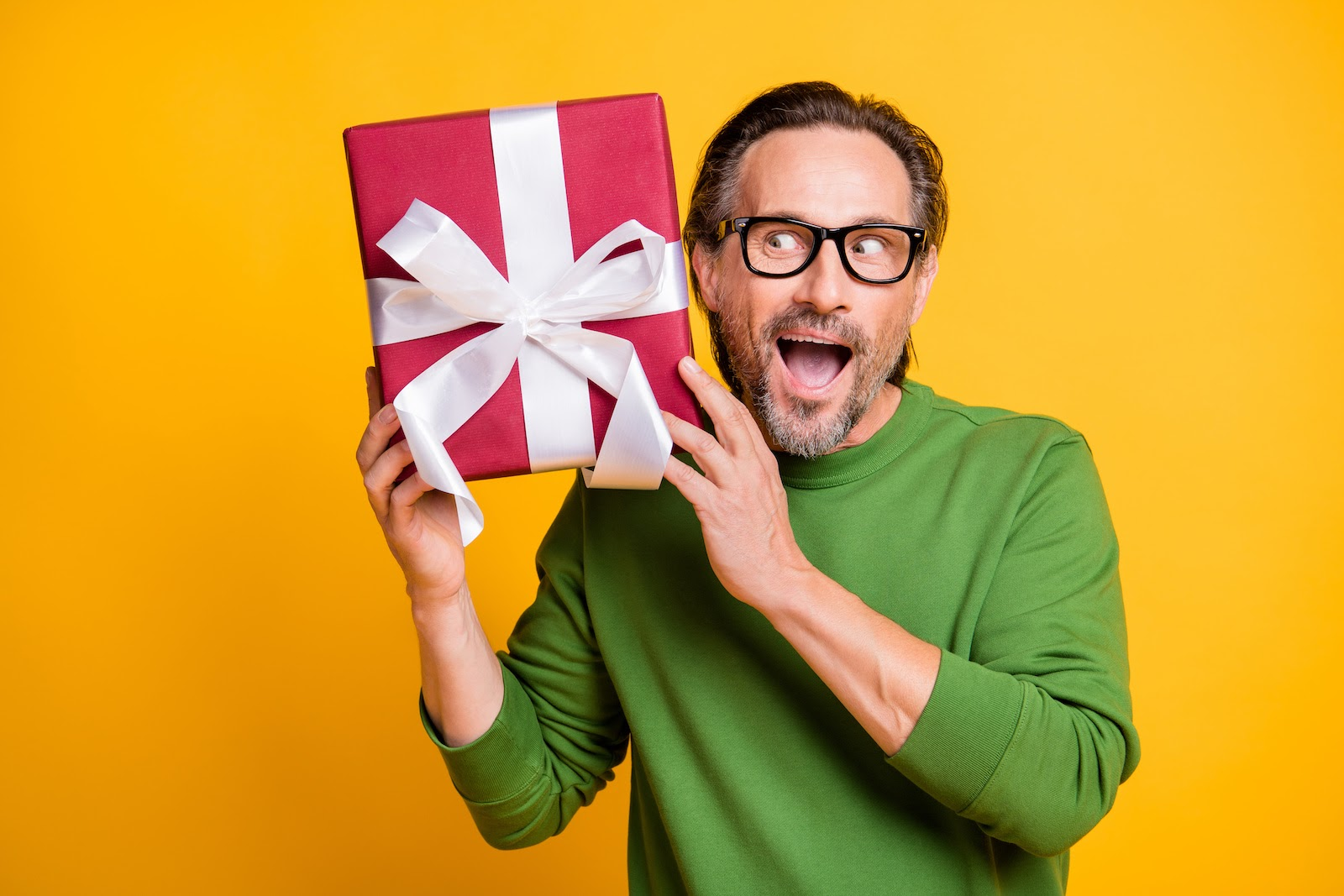 An employee holds a gift box containing a surprise corporate gift idea