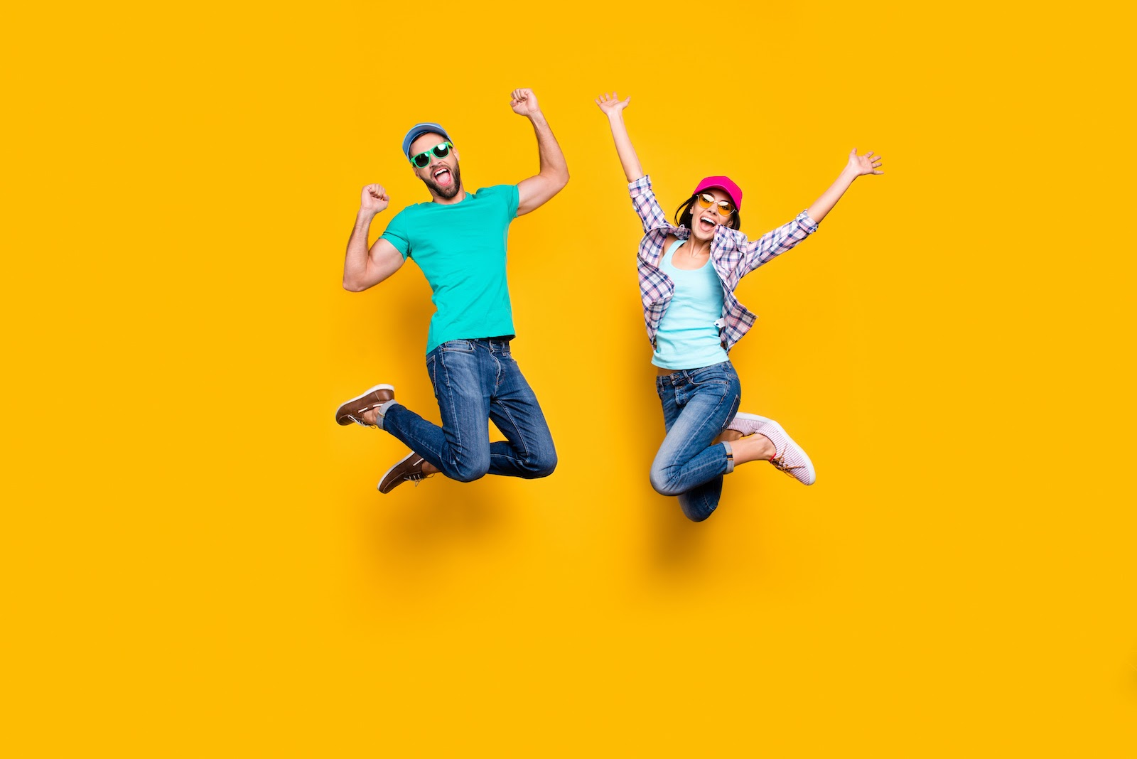 Virtual team members jumping up in excitement in front of a yellow background