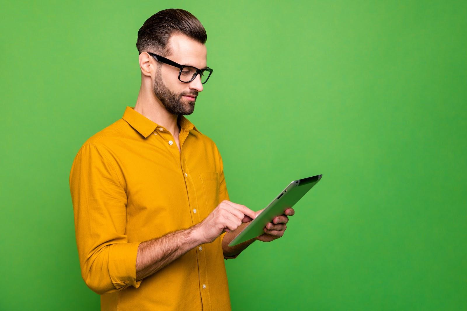 A man uses a virtual event platform on a tablet