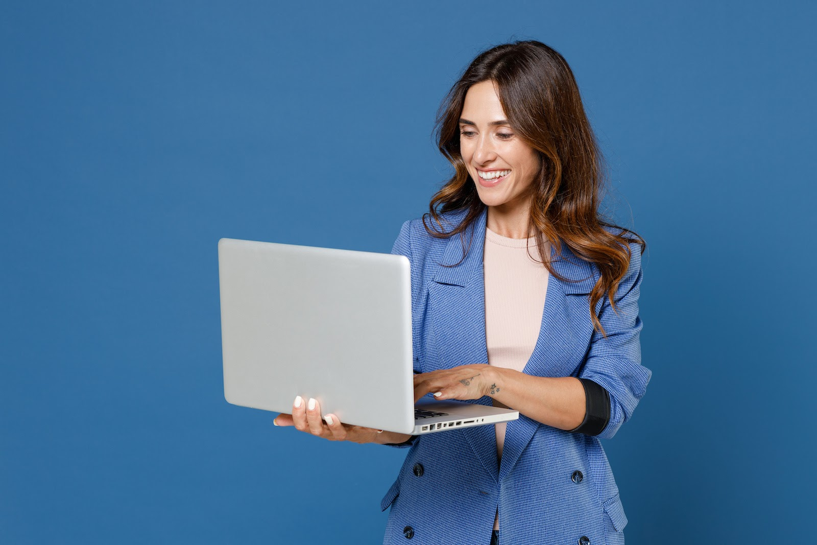 A corporate event planner on her laptop