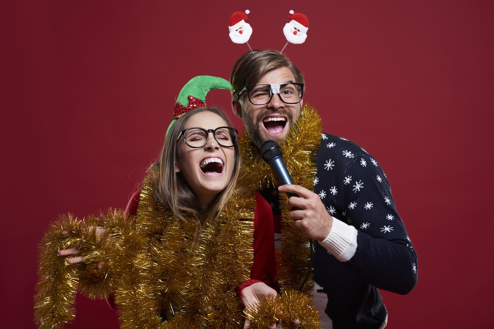 Two virtual holiday party guests sing karaoke