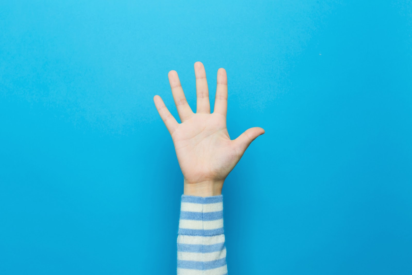 A person raises their hand to participate at a virtual convention