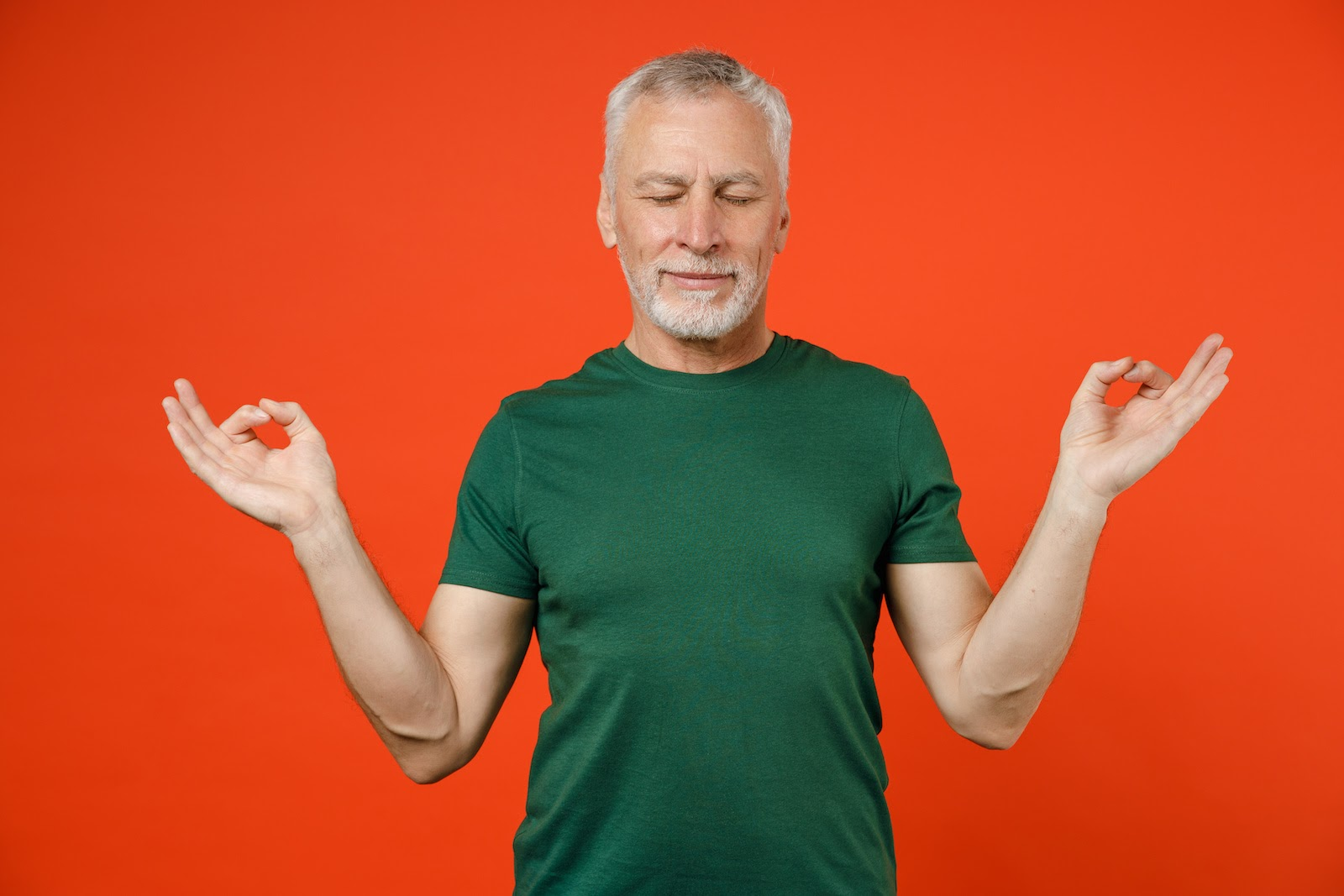 A man meditates as part of a virtual breakout session