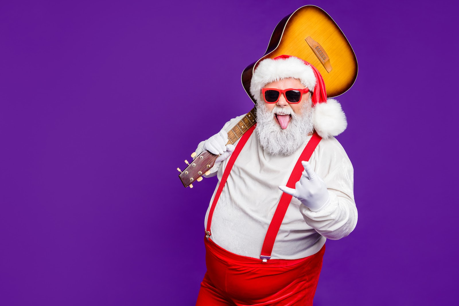 Santa Claus with a guitar performs at a virtual Christmas party