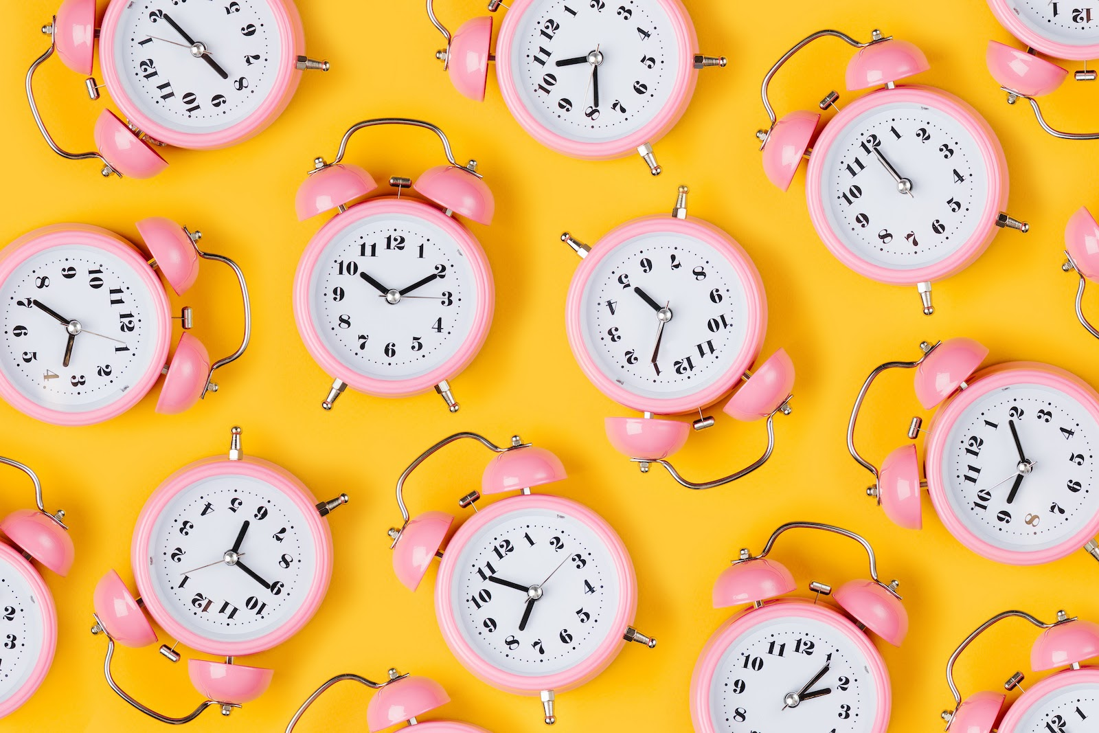 Brightly colored alarm clocks represent time management software