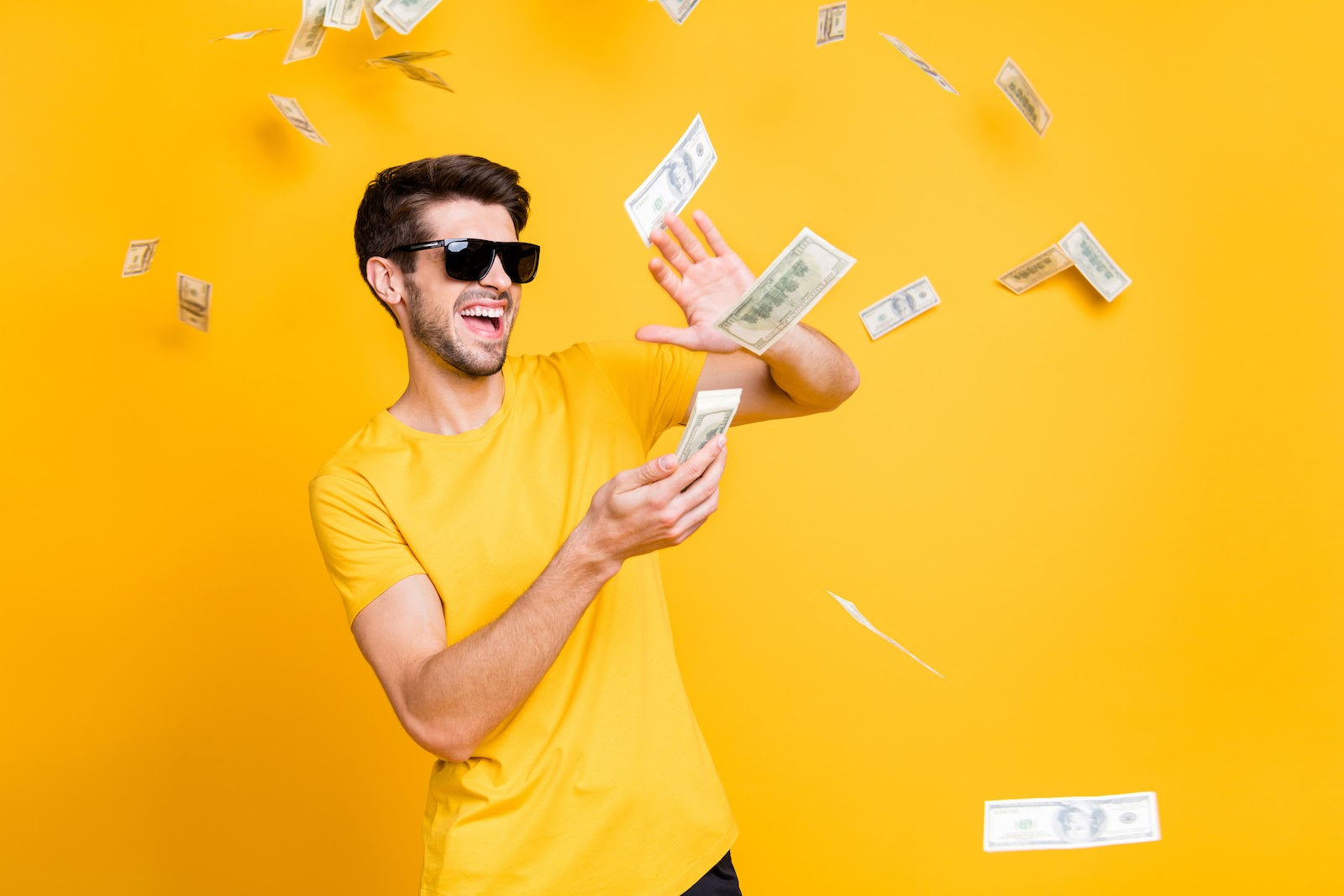 A man throws money in the air to represent investing in experiential marketing