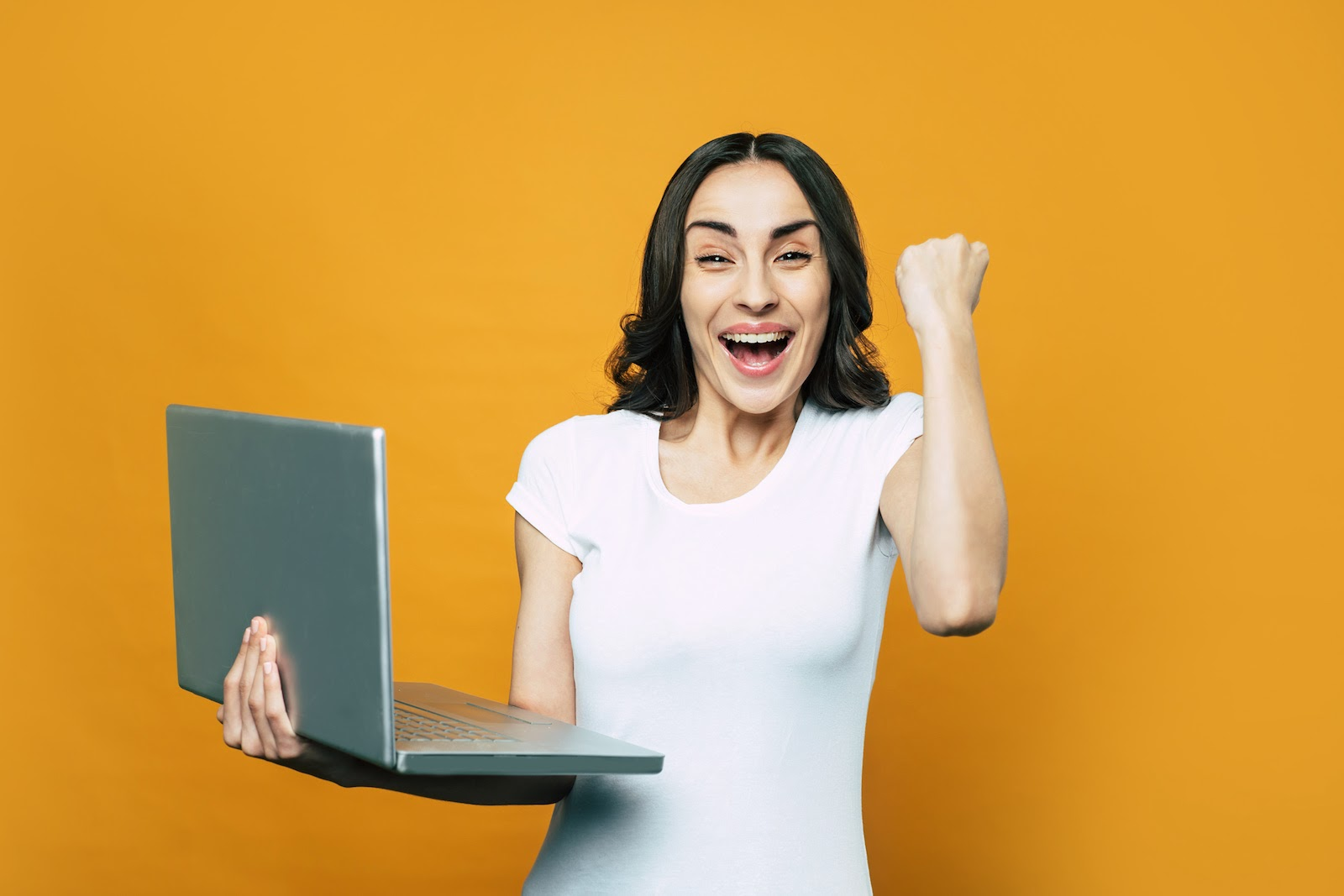 A woman looks happy about her recent virtual sales win