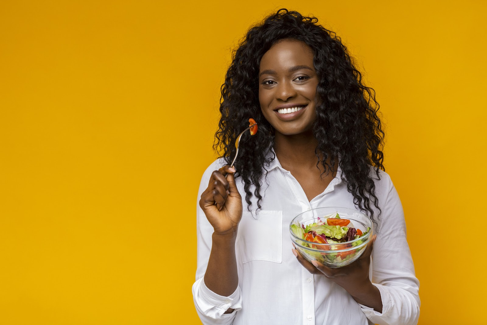 In-person catering ideas: A woman eats a salad