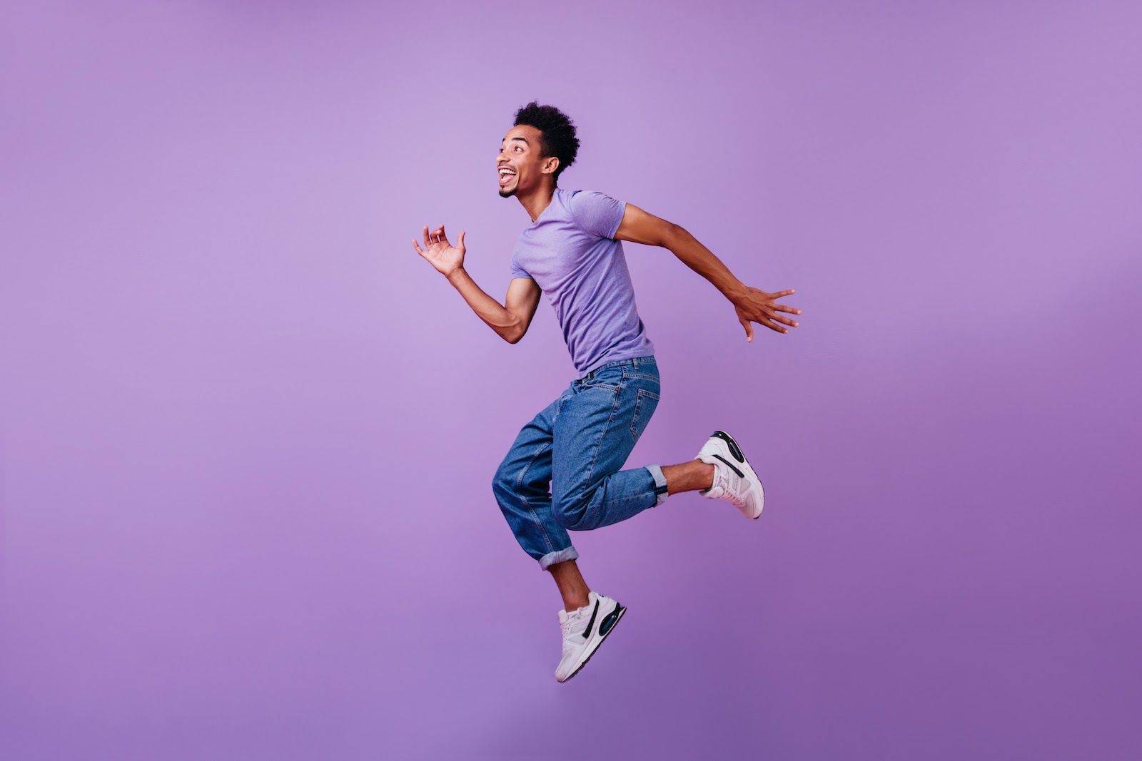 A man jumps in the air, figuratively launching his career with an office administration course