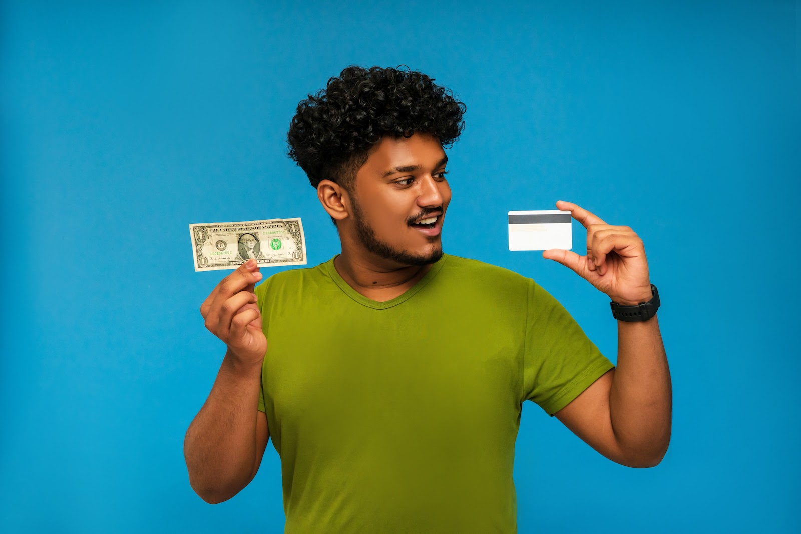 A team member holds up cash and a credit card stipend