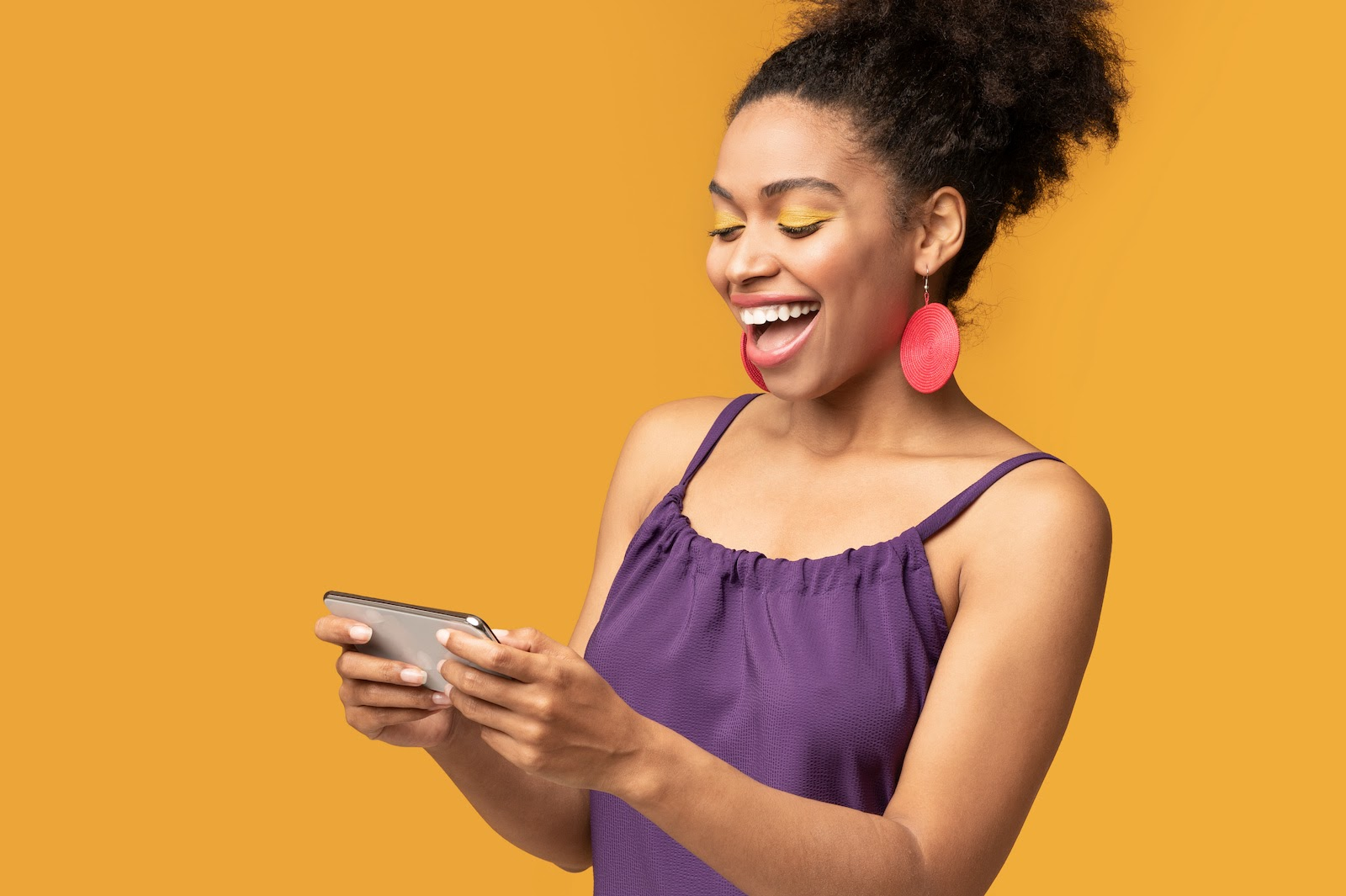 A woman enjoys a gamified engagement marketing experience on her phone