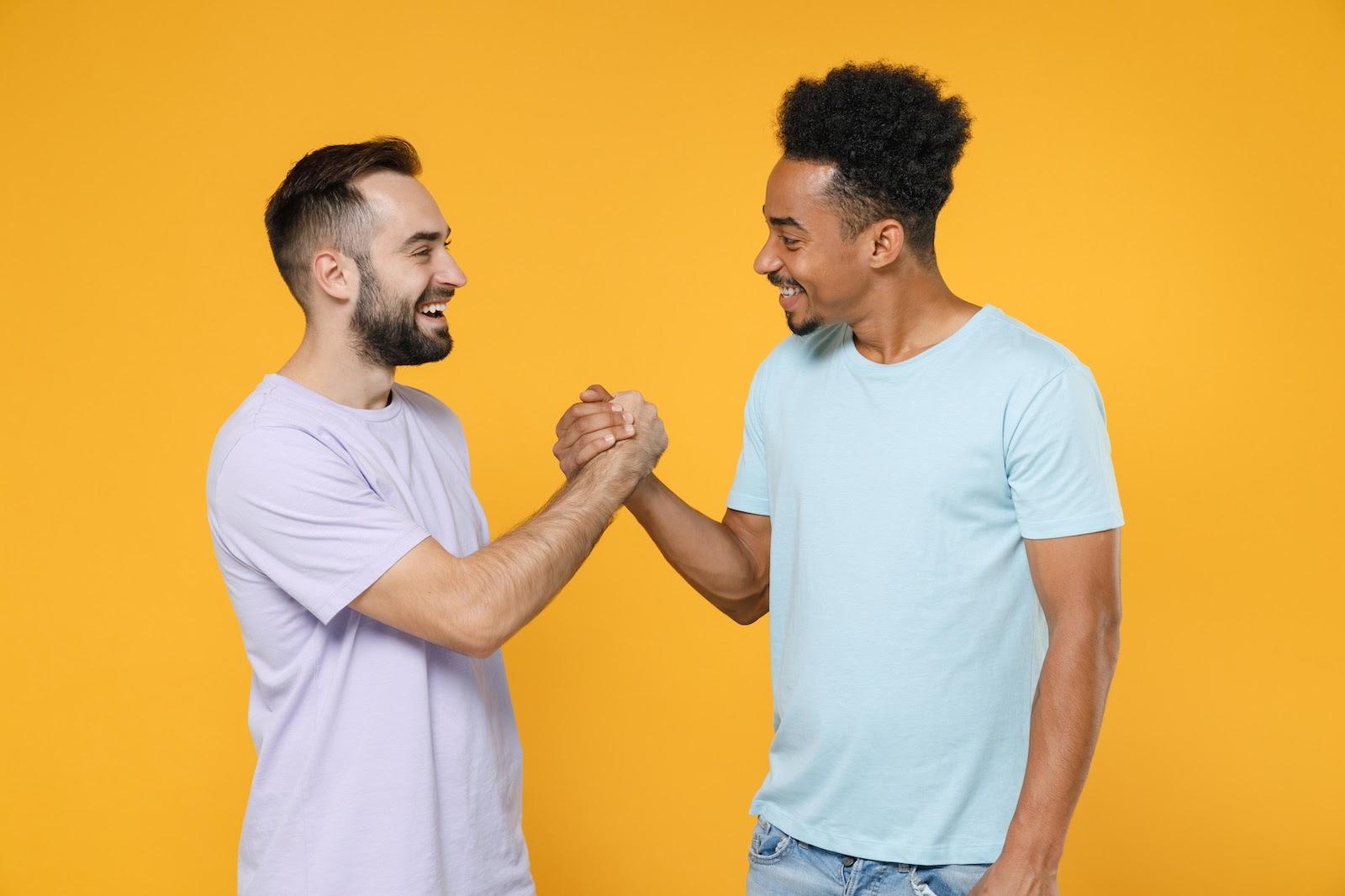 How to run a meeting: Two team members shake hands