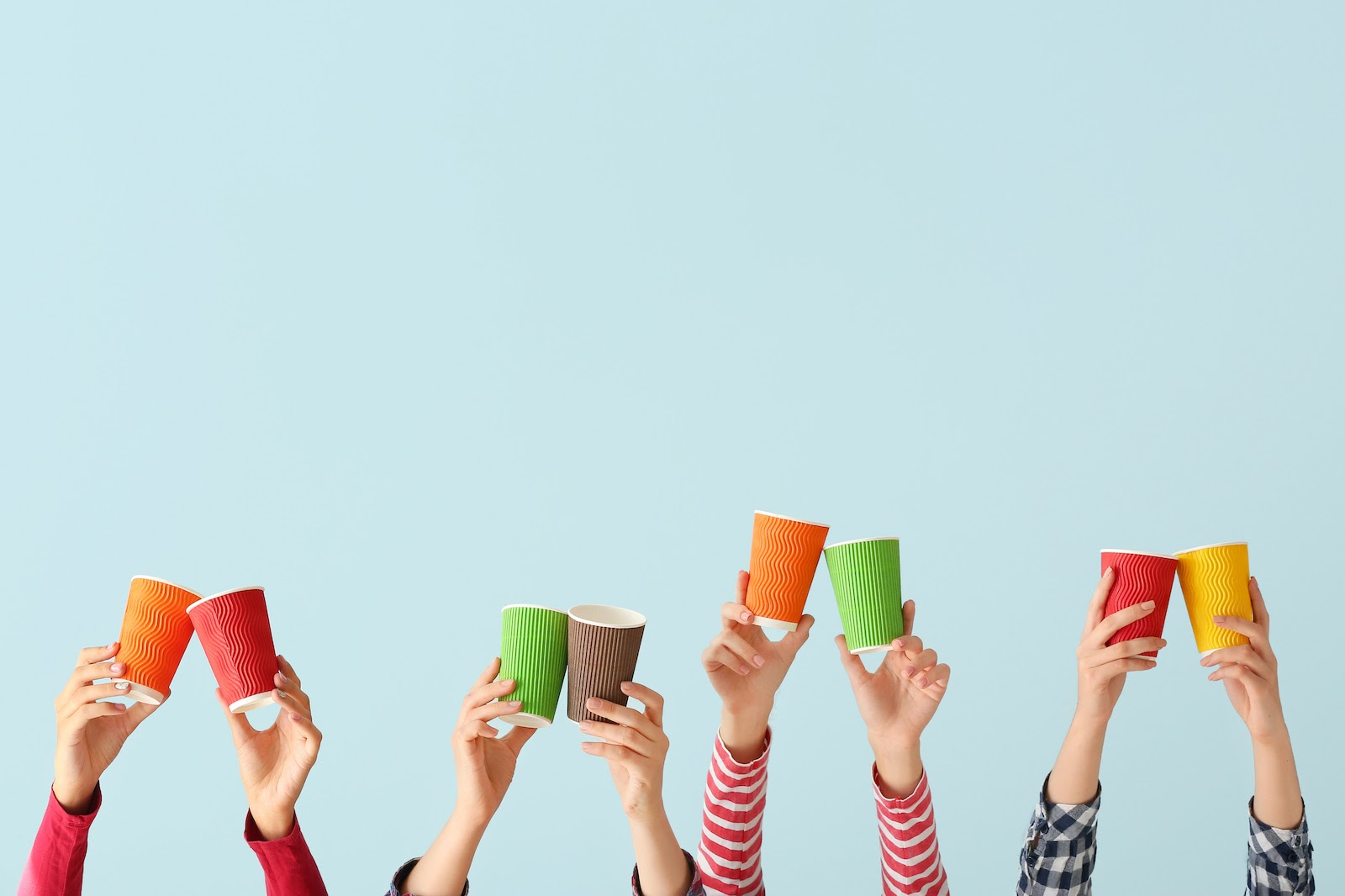Hands hold up coffee cups as a fun virtual meeting perk