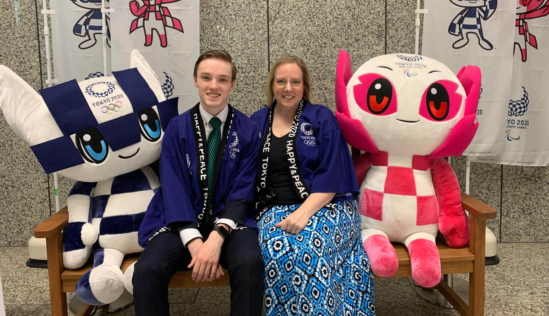 A Teacher and Her Son Sit Between the Olympic Mascots