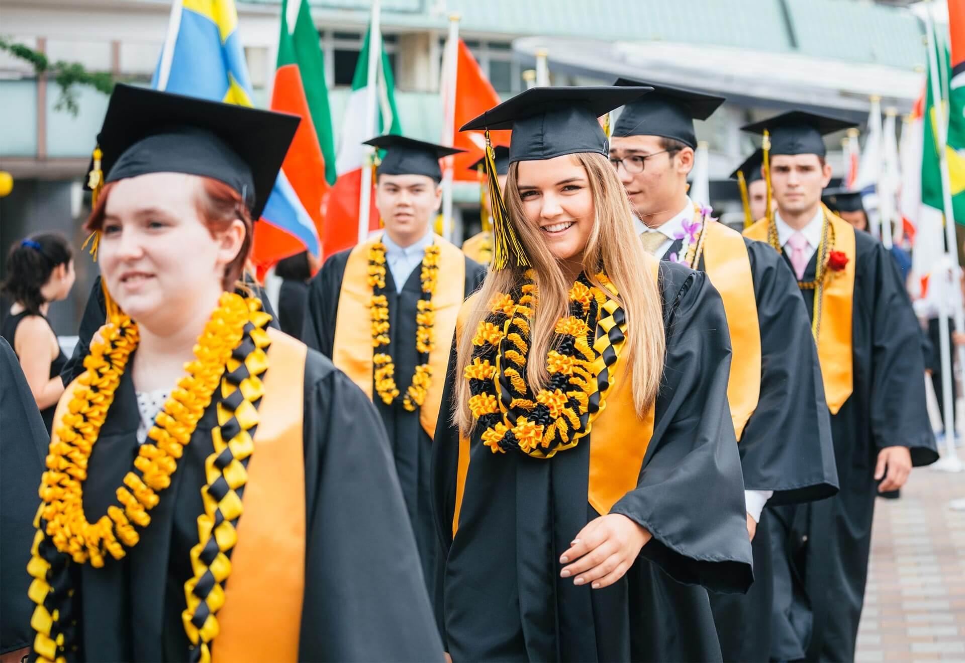 ASIJ Graduate in Cap and Gown at Senior Walk