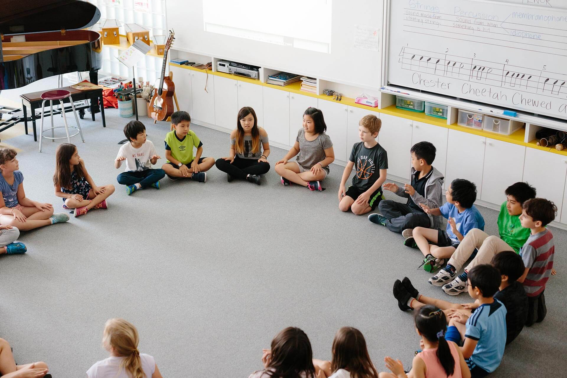 Elementary School Students Circle for Music Class