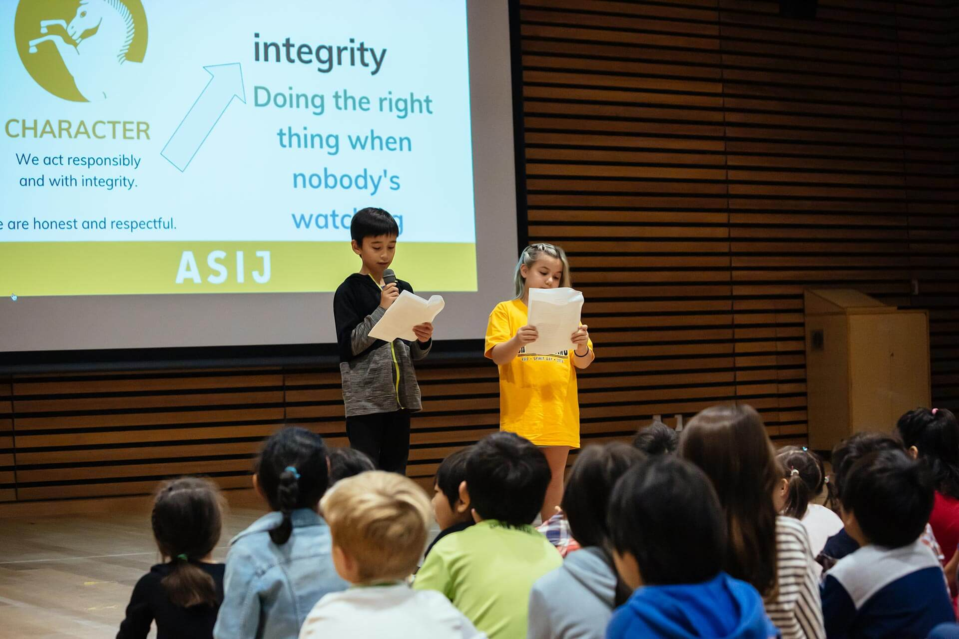 Two Elementary School Students Present at an ES Gathering