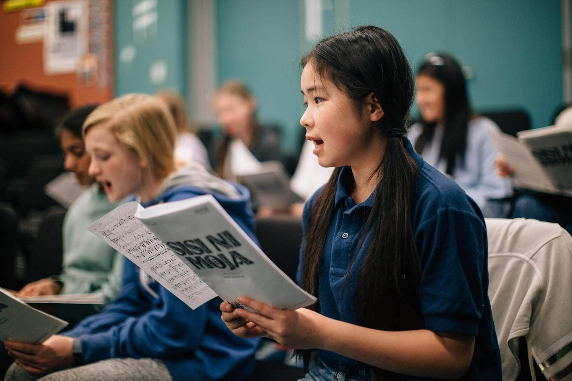 Middle School Students Sing in Music Class