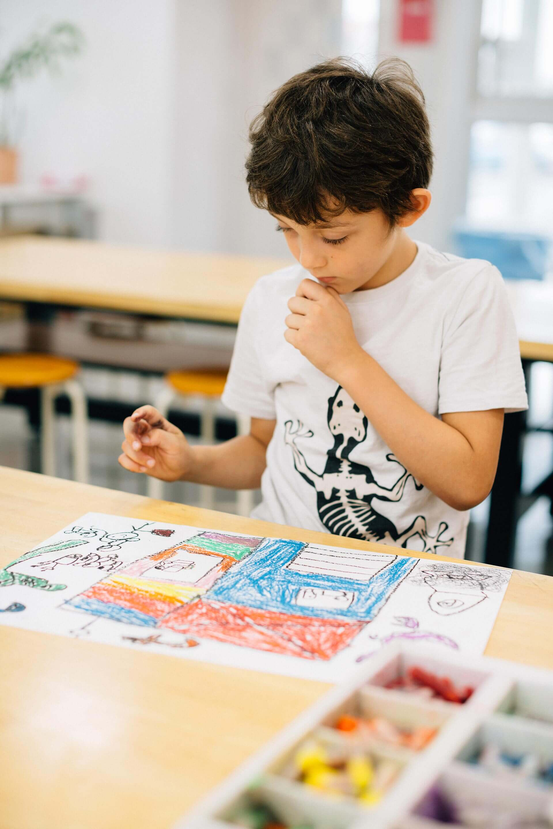 Elementary School Student Drawing in Art Class