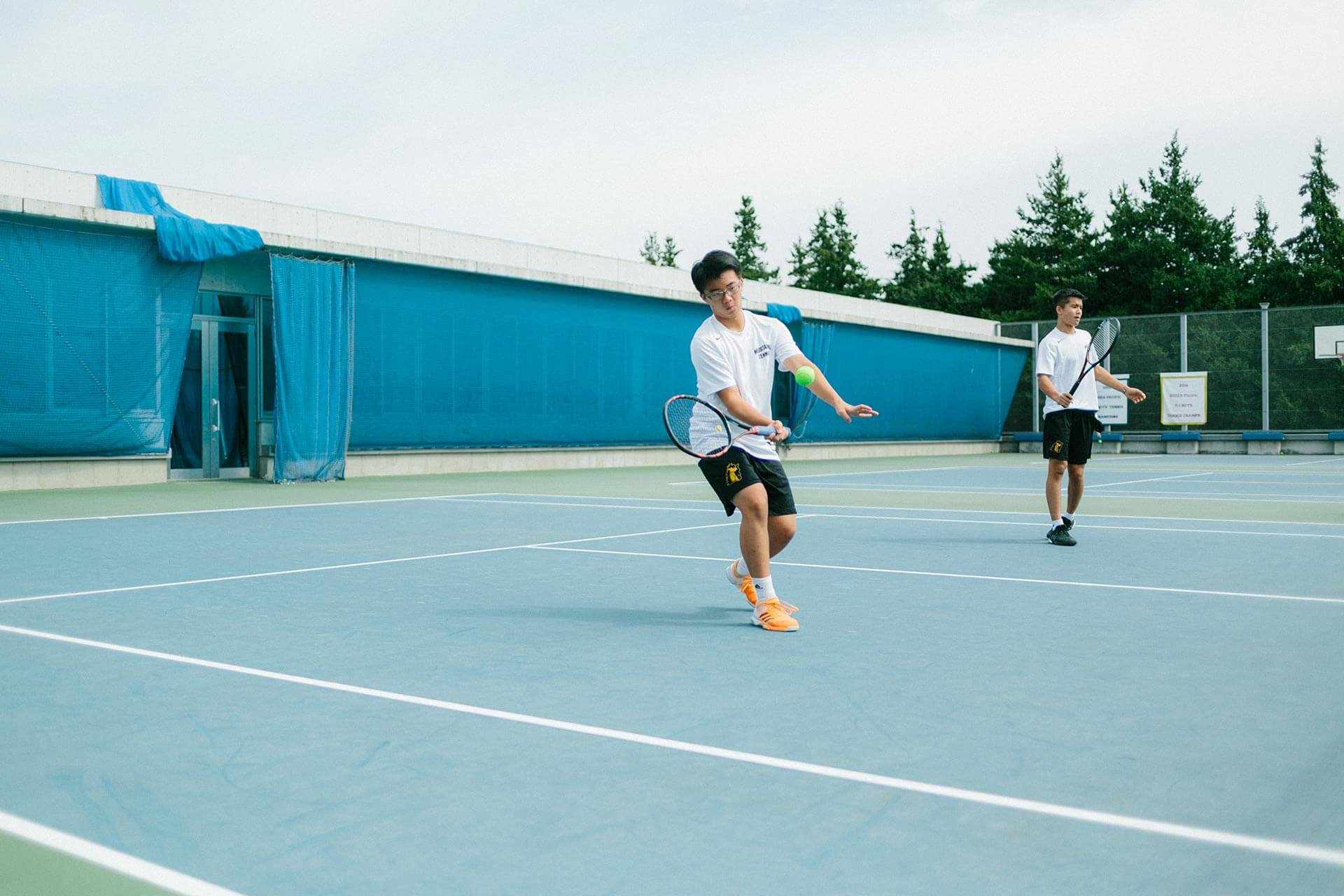 Students Play Tennis on the ASIJ Tennis Courts