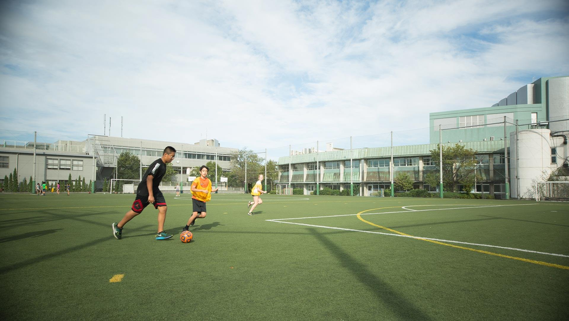 Students Play Soccer on the ASIJ Middle School Field