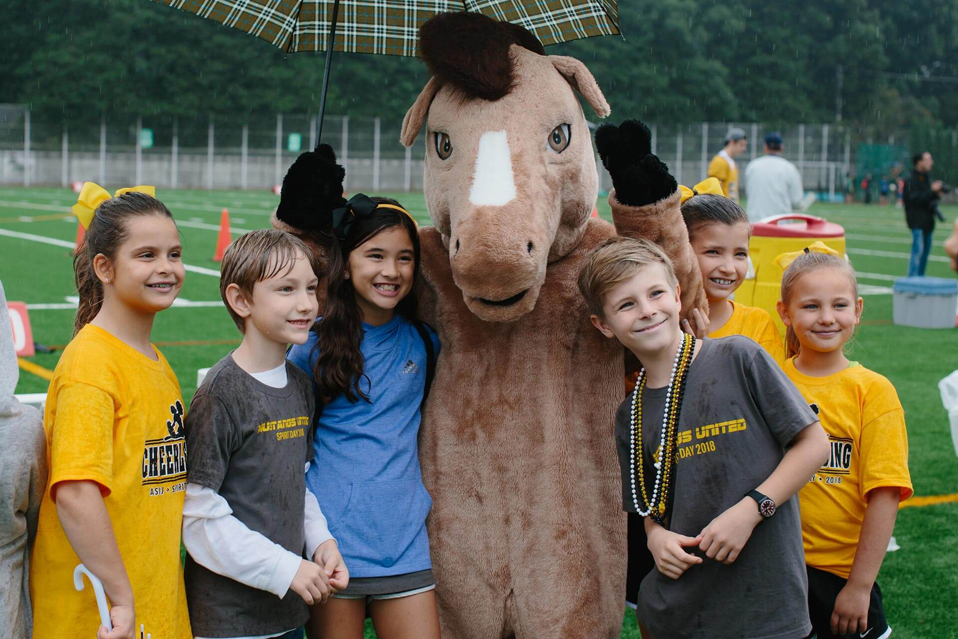 Students Pose with the Mustang Mascot on the ASIJ Field