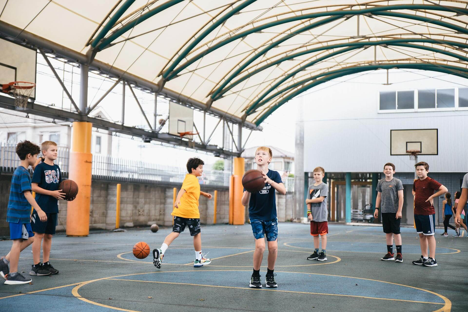 Students Play Basketball on the Elementary School Basketball Courts