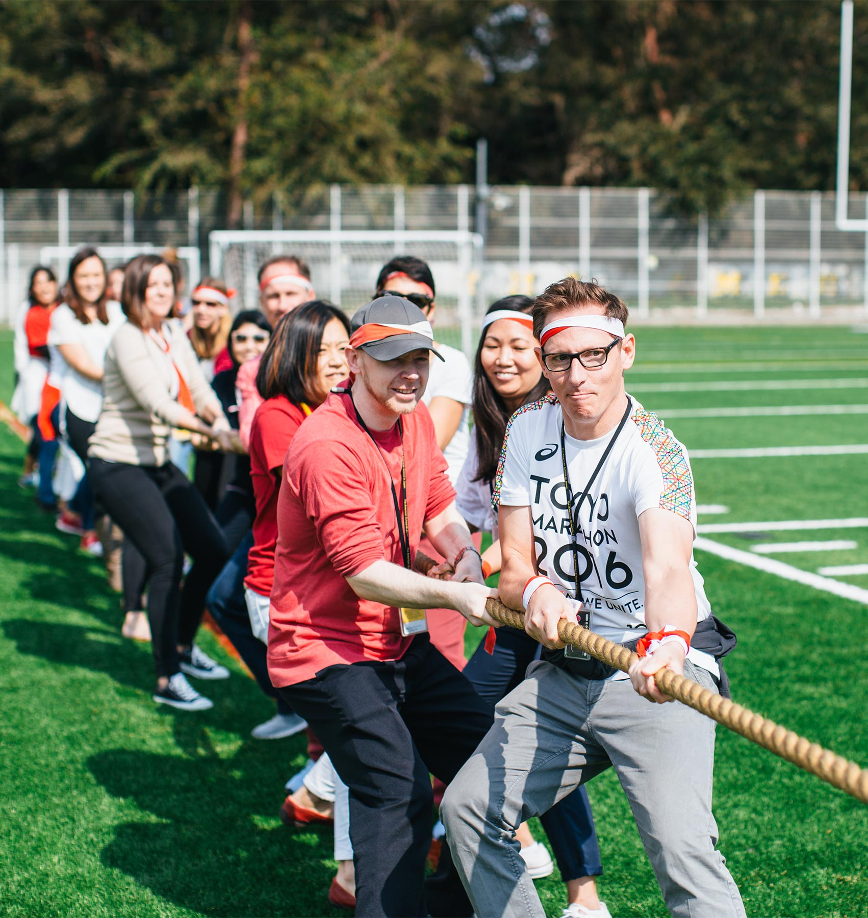 Teachers Participate in Tug of War on Sports Day