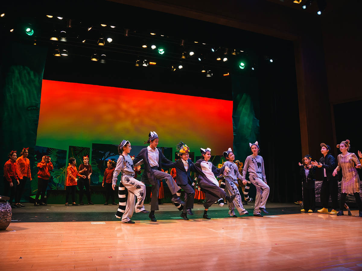 Middle School Students Perform Madagascar on Stage