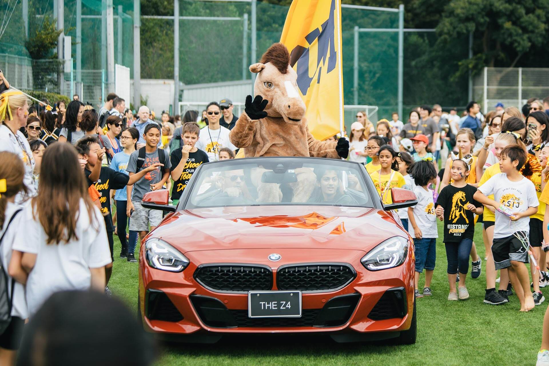 The Mustang Mascot Rides a BMW on Spirit Day