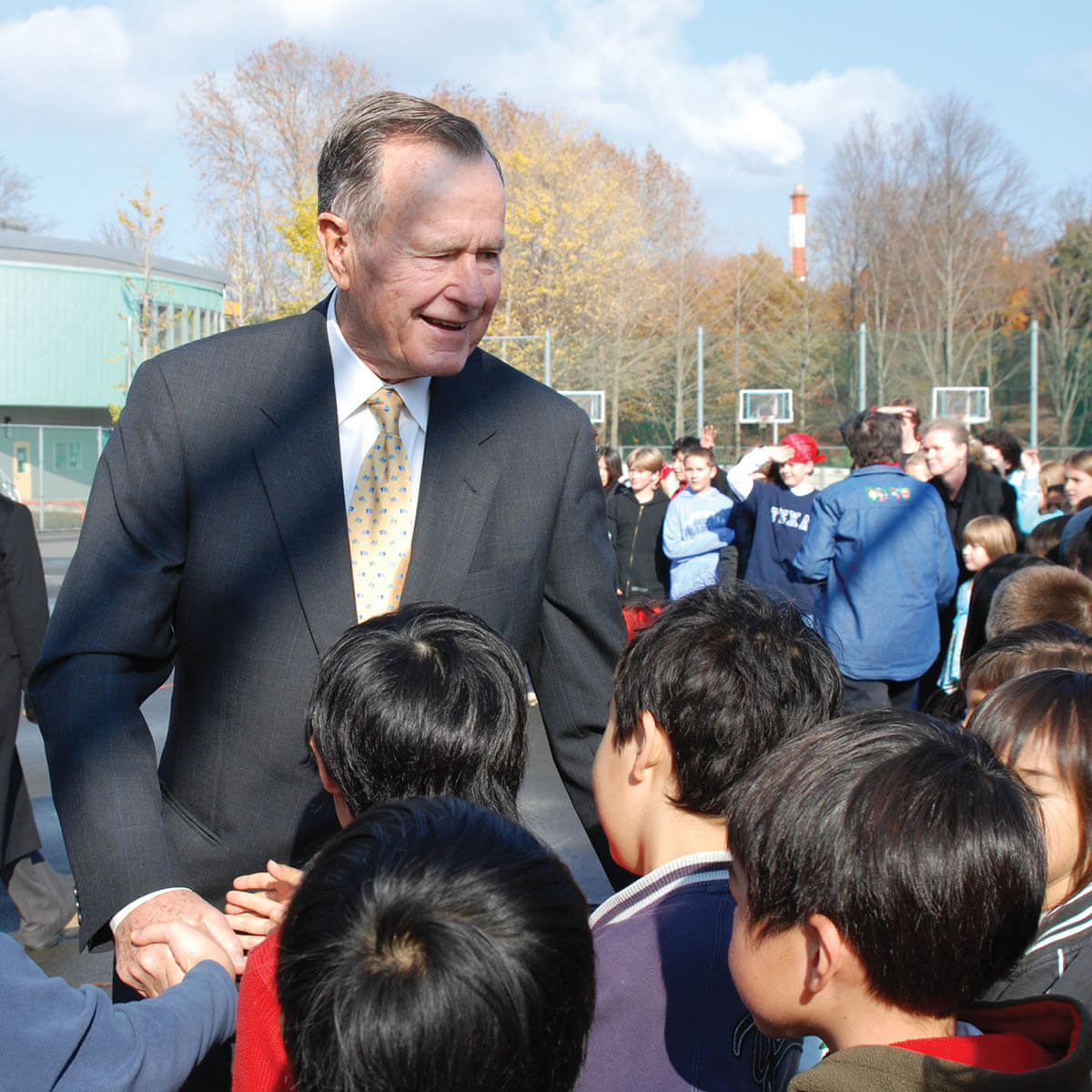 President George H Bush Shakes Elementary Schoolers' Hands at the ASIJ Campus
