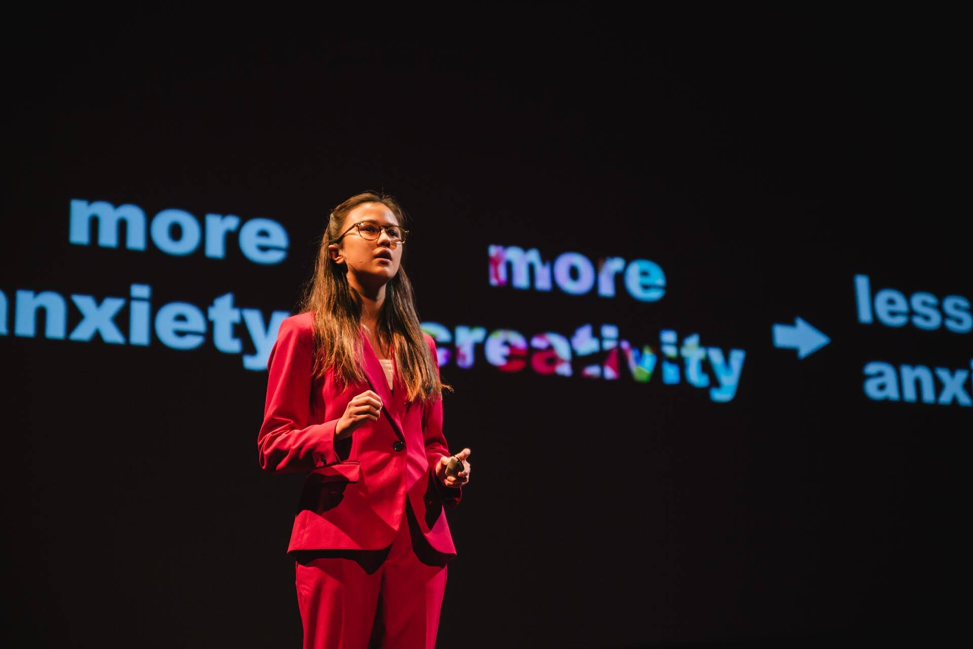 A High School Student in a Red Suit Gives Her TEDx Youth Presentation