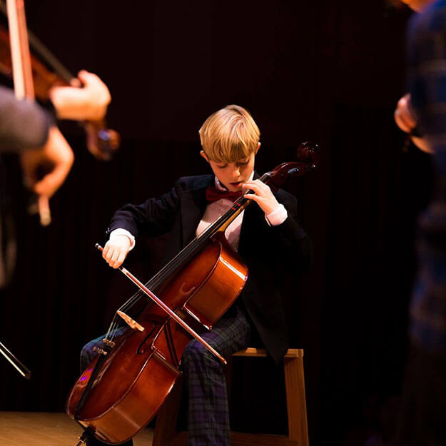 ASIJ Elementary Strings Student Plays Cello