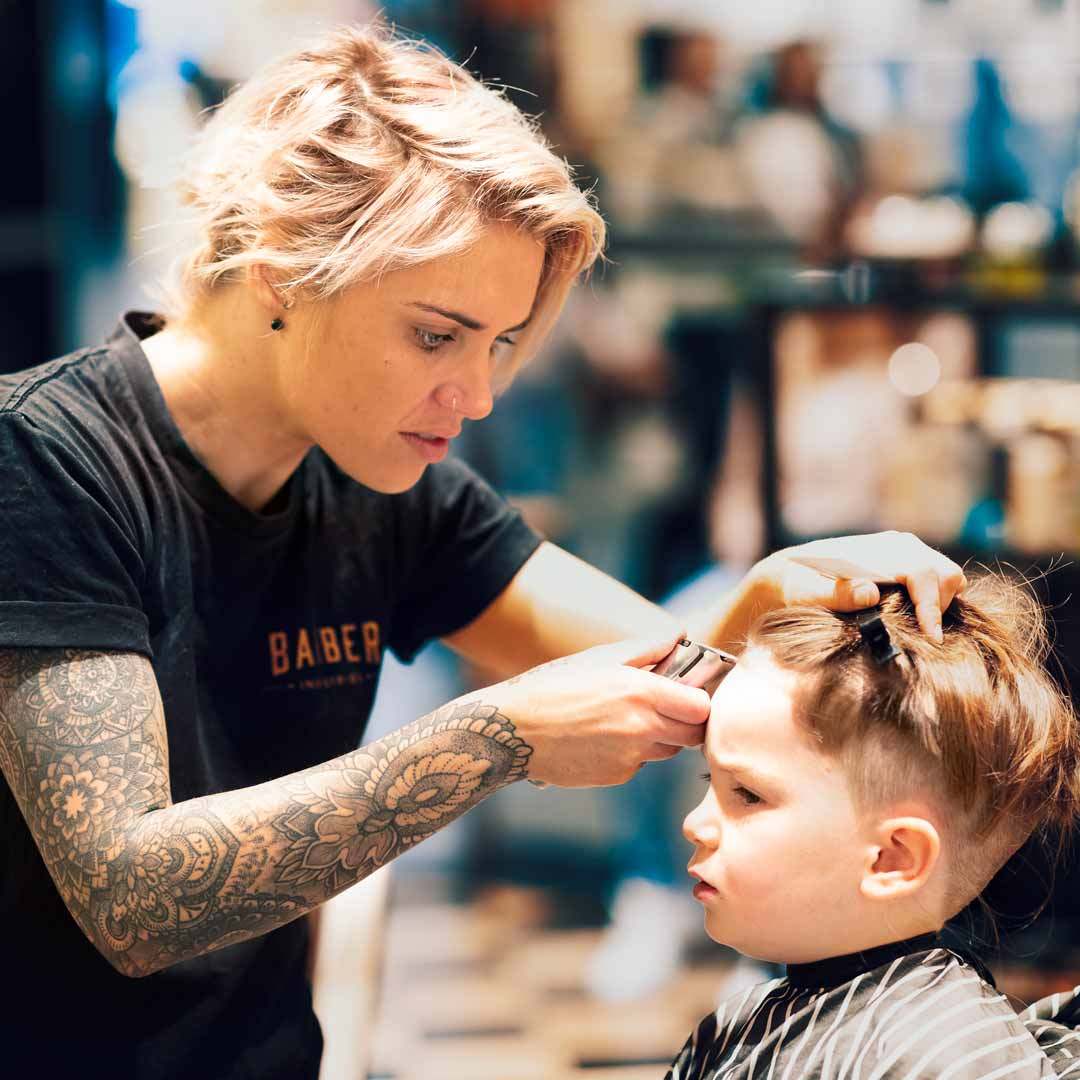 Lady Barber Cutting Childs Hair