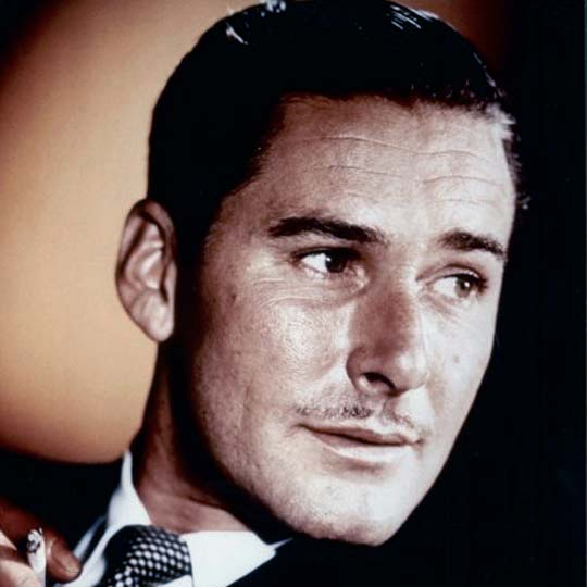 Errol Flynn with his trademark pencil moustache