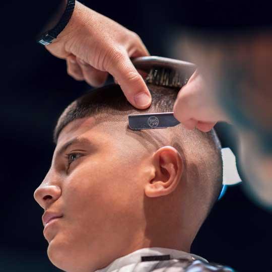 Barber using cutthroat razor on skin fade