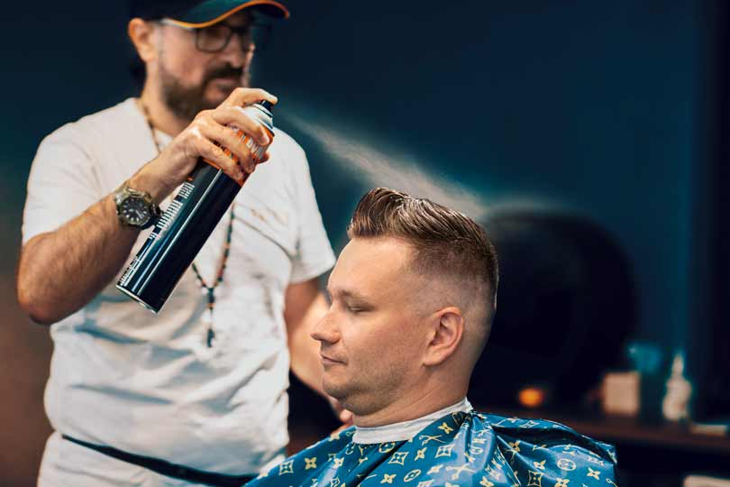 Barber styling hair