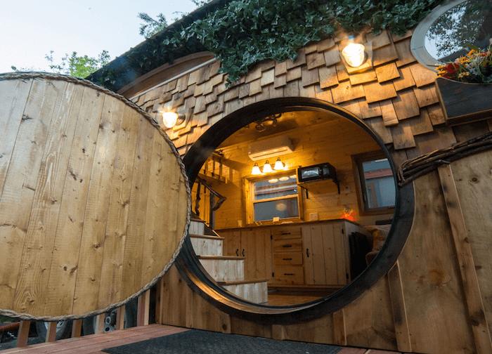 A tiny house with round door at WeeCasa Resort