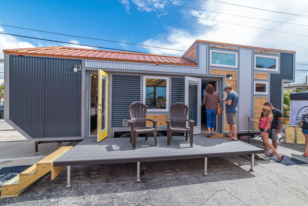 Modern Tiny Home with Main Floor Master Bedroom and 2 foot dual loft extensions along with a nice deck option for outdoor living.